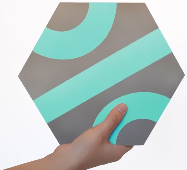 Jednostavna heksagonalna pločica štampana sa linijama ka njenom centru i sa dva polukruga na svakom svom kraju